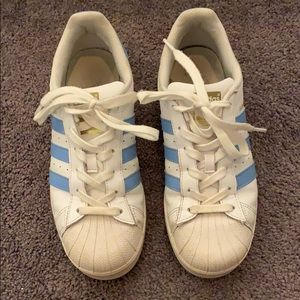 blue and white adidas superstar sneakers